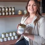 SCENTED CANDLES: Catherine Kwolek is the owner of Aster Candle, a recently launched homemade-candle business in Lincoln. Her coffee milk scented jar candle is a best-seller. / PBN PHOTO/MICHAEL SALERNO