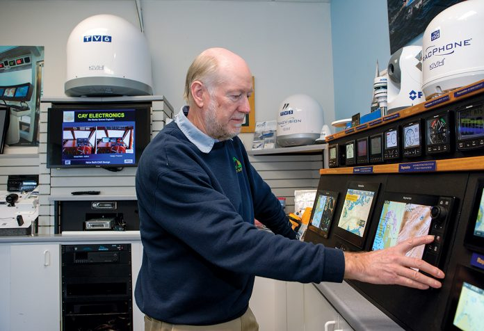 MARINE NAVIGATION: Cay Electronics owner Rufus Van Gruisen in the showroom at the company's headquarters in Portsmouth. Cay supplies, installs and repairs marine navigation and other electrical systems for yachts and powerboats. / PBN PHOTO/KATE WHITNEY LUCEY