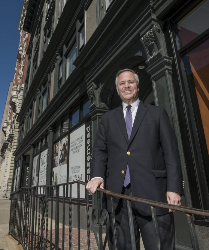 JOESEPH R. PAOLINO JR., owner of Paolino Properties, in front of the new Case-Mead Lofts building at 76 Dorrance St., Providence. / PBN PHOTO/MICHAEL SALERNO