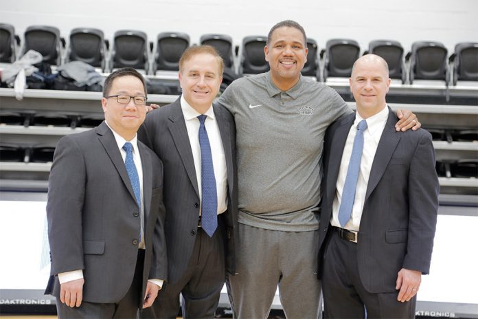 FROM LEFT, William T. Chen, physician at University Gastroenterology; Dr. Thomas Sepe, president of University Gastroenterology; Ed Cooley, men's basketball head coach for Providence College; and Eric Newton, physician at University Gastroenterology and a clinical associate professor of medicine at the Warren Alpert Medical School of Brown University, are encouraging people to get screened for colon cancer. / COURTESY UNIVERSITY GASTROENTEROLOGY