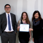 FROM LEFT, HealthSource RI for Employers Director Zachary Sherman presents Providence Power Yoga owner JoEllen Hockenbrough and Director of Studio Operations Amy Ravenelle with a congratulatory certificate for being the organization's 700th customer. / COURTESY HEALTHSOURCE RI