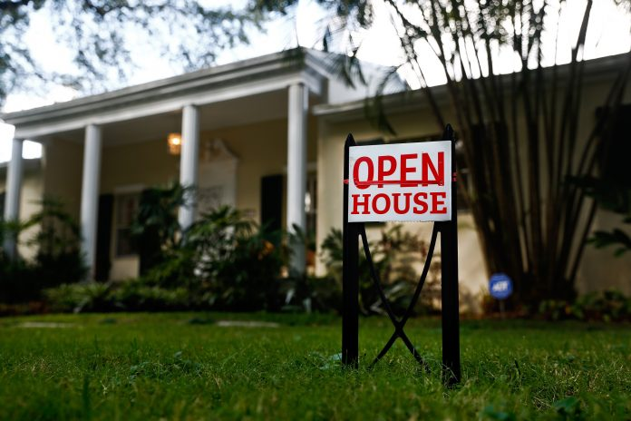 U.S. EXISTING HOME SALES rose 3 percent month to month in February and median sales price rose 5.9 percent year over year to $241,700. / BLOOMBERG FILE PHOTO/SCOTT MCINTYRE