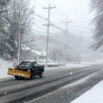 HOPKINS HILL ROAD in Coventry was beginning to be covered in snow despite the efforts of plow trucks early on Tuesday. The nor'easter that is hitting New England is still expected to dump upwards of a foot of show or more in the region. / PBN PHOTO/ROB BORKOWSKI