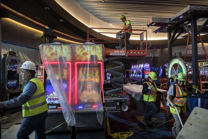 CONSTRUCTION EMPLOYMENT ROSE BY 61,000 jobs year over year, including work such as is happening here, where workers finish construction on the gaming floor of the Resorts World Catskills casino, hotel and entertainment complex, operated by Empire Resorts Inc. in Monticello, N.Y., in January. / BLOOMBERG NEWS FILE PHOTO/VICTOR J. BLUE