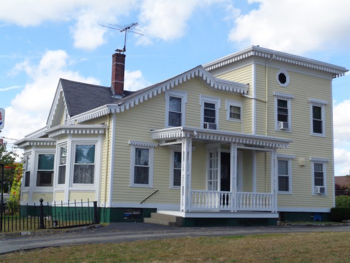 THE POTTER-COLLYER HOUSE, at 67 Cedar St., was recently awarded a historic marker by the Preservation Society of Pawtucket. Originally built in 1863, it was augmented and expanded in 1877, 1895 and 1902, and was moved from its original location on the west side of Pine Street in 1962 during the construction of Interstate 95. / COURTESY PRESERVATION SOCIETY OF PAWTUCKET