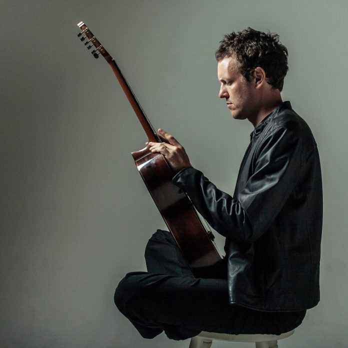 DEREK GRIPPER of Cape Town, South Africa, poses with his classical guitar. Gripper will be one of the featured artists at the University of Rhode Island's third annual Guitar Festival April 6-8. / COURTESY DEREK GRIPPER