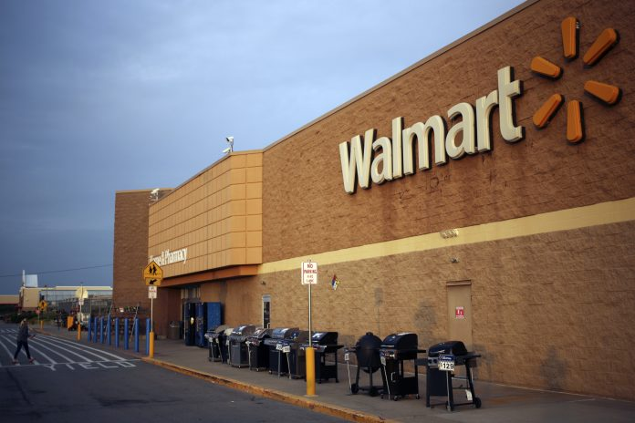 WALMART IS EXPERIMENTING with a number of ways to bring down its health care costs, including setting up accountable care organizations at many of its employment centers, where the retailer buys care directly from providers. / BLOOMBERG NEWS FILE PHOTO/LUKE SHARRETT