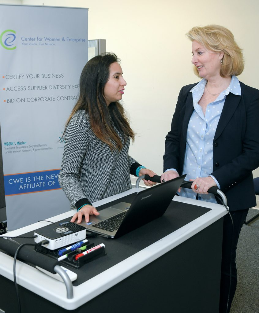 GUIDING ENTREPRENEURS: Maryellen O'Mahony, right, director of the Center for Women & Enterprise in Rhode Island, speaks with Maria Carranza, business-planning instructor.  / PBN PHOTO/MICHAEL SALERNO