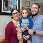 MAKING MEMORIES: Ivette Luna, lead consumer-engagement specialist at Blue Cross & Blue Shield of Rhode Island, with her 2-year-old son Daniel and husband, Jose. The family portrait on the wall was taken during a trip to the Dominican Republic.