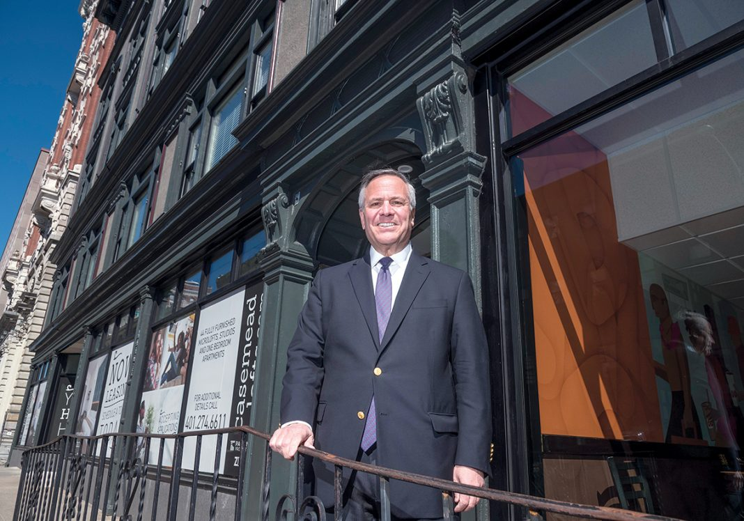 MICRO-LOFTS: Joseph R. Paolino Jr., managing partner of Paolino Properties, stands in front of the new Case-Mead Lofts building at 76 Dorrance St. The Case-Mead Lofts are a renovation of a former office building into 44 micro-loft apartments.  / PBN PHOTO/