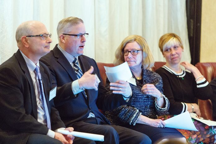 INSIDE KNOWLEDGE: Members of the first panel at the 2018 Spring Providence Business News Health Care Summit April 6 at the Providence Marriott Downtown: from left, Dr. Gus Manocchia of Blue Cross & Blue Shield of Rhode Island; Stephen Farrell, CEO of UnitedHealthcare of New England; Dr. Claire Levesque, board-certified neurologist and chief medical officer for commercial products at Tufts Health Plan; and Joan Kwiatkowski, CEO of CareLink and the PACE Organization of Rhode Island. / PBN PHOTO/RUPERT WHITELEY
