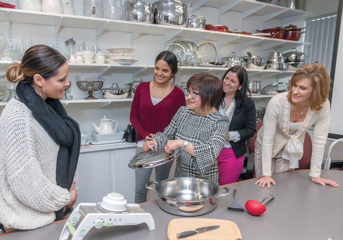STEADY SELLER: Direct selling business Princess House in Taunton produces a variety of products. From left, Nicole Camarao, associate product-development manager; Valerie Vega, product planner; Connie Tang, president and CEO; Mayari Genova, senior product manager; and Michelle Hannula, senior product manager. / PBN PHOTO/MICHAEL SALERNO