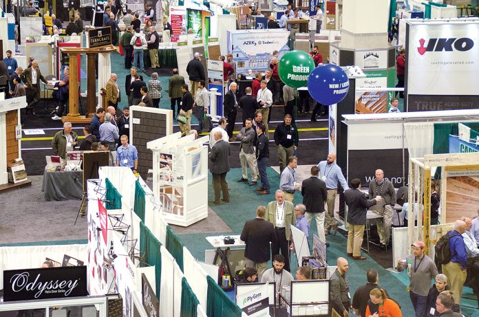 SHOW FLOOR: Attendees and exhibitors interact at the Northeastern Retail Lumber Association expo hall at the R.I. Convention Center in Providence. Over the three days the NRLA expo was held in February, attendees booked 3,052 hotel rooms and spent $1.13 million. / COURTESY NRLA