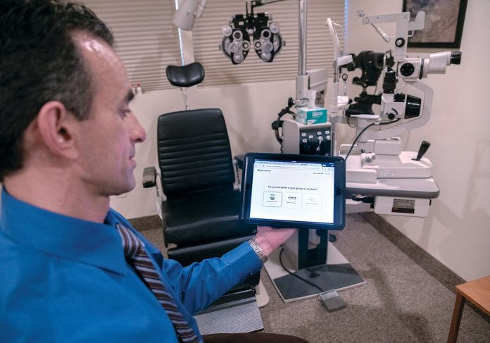 NEW TECH: Dr. Stephen M. Montaquila, an optometrist at West Bay Eye Associates in Warwick, helped draft a bill regulating the use of vision-test apps, in part to ensure they aren't used to skirt the healthy requirement for routine eye exams. / PBN PHOTO/­MICHAEL SALERNO