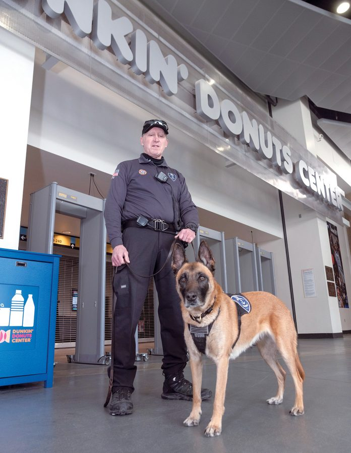 SECURITY TEAM: Officer Lincoln Sisson and Kyra, a 6-year-old female Belgian Malinois, are part of the Dunkin' Donuts Center homeland security team that does sweeps of the facility and guests in advance of and during events. / PBN PHOTO/MICHAEL SALERNO