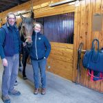 EQUINE CARE: Ocean State Equine Associates owners and veterinarians Dr. Enda Currid, left, and Dr. Hollie Stillwell with Lady, a 15-year-old Dutch Warmblood. The equine veterinary practice in Scituate offers routine wellness care, emergency medicine and equine surgery in Rhode Island, Massachusetts and surrounding areas. / PBN PHOTO/MICHAEL SALERNO