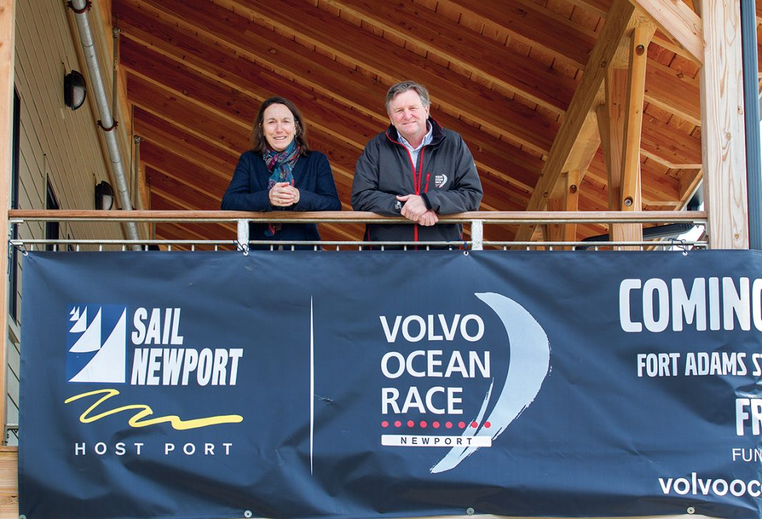 BANNER EVENT: Sail Newport Executive Director Brad Read, this year's Volvo Ocean Race stopover executive director, and Sue Maffei Plowden, race event director, stand on the porch of the Sail Newport Sailing Center with the banner for Volvo Ocean Race Newport. The city is the lone North American stopover for the 2017-18 international race. / PBN PHOTO/KATE WHITNEY LUCEY