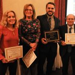 PBN STAFF WRITER Eli Sherman, second from right, earned first place honors in the Rhode Island Press Association's annual journalism contest in the Investigative/Analytical News Story category ahead of the Providence Journal's Amanda Milkovits, left, Katherine Gregg and representing Katie Mulvaney on the far right, Journal Executive Editor Alan Rosenberg. / COURTESY PAUL J. SPETRINI PHOTOGRAPHY
