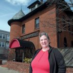 ENDANGERED PROPERTY: Barbara Zdravesky, president of the Preservation Society of Pawtucket, in front of Hose Company No. 6 on Central Avenue in Pawtucket. The society says the commercial building is being threatened with demolition. / PBN PHOTO/MICHAEL SALERNO