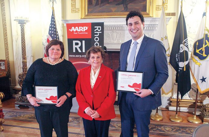 CAPITOL CAREGIVERS: Sen. Maryellen Goodwin, left, and Rep. Aaron ­Regunberg, right, were named 2017 AARP Capitol Caregivers for their earned paid sick leave legislation passed last year. They are pictured with AARP Rhode Island Director Kathleen Connell holding their certificates. / COURTESY AARP