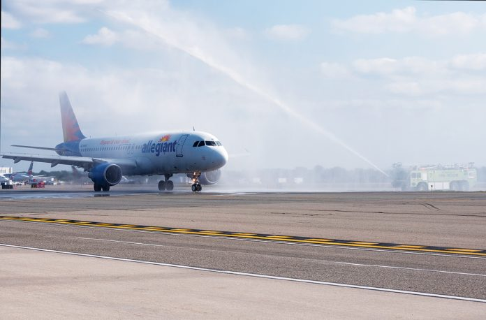 WELCOMING ALLEGIANT: A fire engine shoots a stream of water into the air in celebration of the first flight of Allegiant Air to T.F. Green Airport in September. / PBN PHOTO/MICHAEL SALERNO