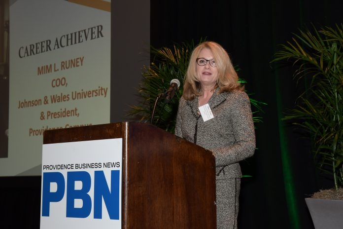 JOHNSON & WALES UNIVERSITY Chief Operating Officer and President of the Providence Campus Mim L. Runey speak to the crowd at PBN's third annual C-Suite Awards dinner after receiving the program's Career Achiever award. / PBN PHOTO/MIKE SKORSKI