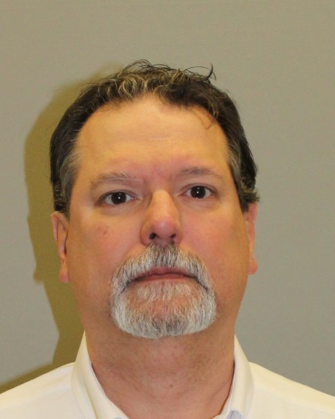 FORMER WARWICK LAWYER, Vincent J. Mitchell, who specialized in estate planning and long-term health care planning, has been charged with 10 counts of embezzlement and fraudulent conversion based on his admission that he had taken more than $1.2 million from 10 clients. / COURTESY R.I. STATE POLICE