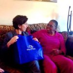 GOV. GINA M. RAIMONDO, left, delivers a meal to a woman during the 2017 March for Meals Campaign. / COURTESY MEALS ON WHEELS OF RHODE ISLAND