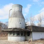 """OWNERS OF THE """"Milk Can"""" building on Route 146 in North Smithfield are planning to repurpose the structure shaped like a farmer's milk bottle into a new mixed-use development. / PBN PHOTO/JAMES BESSETTE"""
