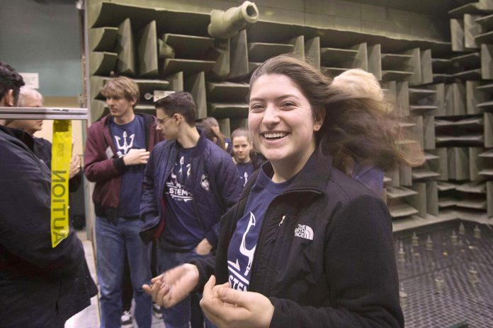 SOFIA RICCIARDI, foreground, a sophomore electrical engineering student at the University of Connecticut, tests out the wind tunnel at the Naval Undersea Warfare Center in Newport. / COURTESY NUWC