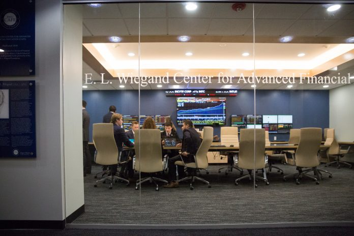 ROGER WILLIAMS UNIVERSITY students at work in the new Center for Advanced Financial Education at the Mario J. Gabelli School of Business in Bristol. / COURTESY ROGER WILLIAMS UNIVERSITY/JAMES JONES