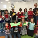 HANNAH CHUNG, back left, founder of Sproutel, with Rocky Hill Lower School students in February. The Providence-based research and development workshop has been named Rocky Hill School's entrepreneur in residence. / COURTESY SPROUTEL