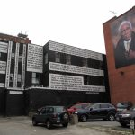 THE MURAL on the left is on the rear of the AS220 building downtown. At right, one of the portraits in the city-funded Seen Unseen grouping. /PBN FILE PHOTO/MARK S. MURPHY