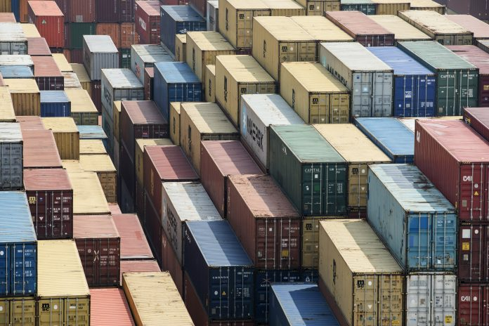 THE TRADE CONFLICT between the United States and China, the two largest economies in the world, appears to be easing. Shipping containers stand in a terminal at the Yangshan Deep Water Port in Shanghai in March. / QILAI SHEN/BLOOMBERG NEWS PHOTO