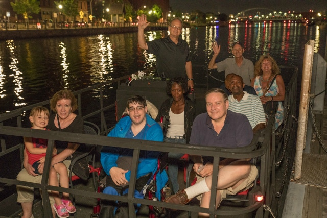 WATERFIRE PROVIDENCE has launched a Kickstarter campaign to fund an upgraded boat for its Access Program which allows persons with disabilities and mobility concerns to view the event from a large, handicap accessible pontoon boat. / PHOTO BY KEVIN MURRAY / COURTESY WATERFIRE PROVIDENCE