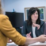 OBSTACLE JUMPER: Lisa Dandeneau, chief operating officer of Navigant Credit Union, meets with Eliza Lavergne, vice president, project management, at the credit union's Smithfield office. / PBN PHOTO/RUPERT WHITELEY