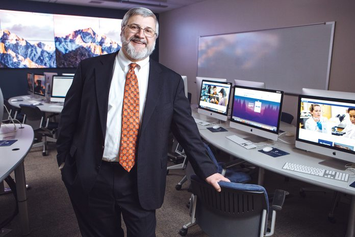 TECH IN FRONT: Jacques Laflamme, New England Institute of Technology's chief information officer, has supervised the physical and intellectual expansion of technology for the school during the last three years. / PBN PHOTO/RUPERT WHITELEY