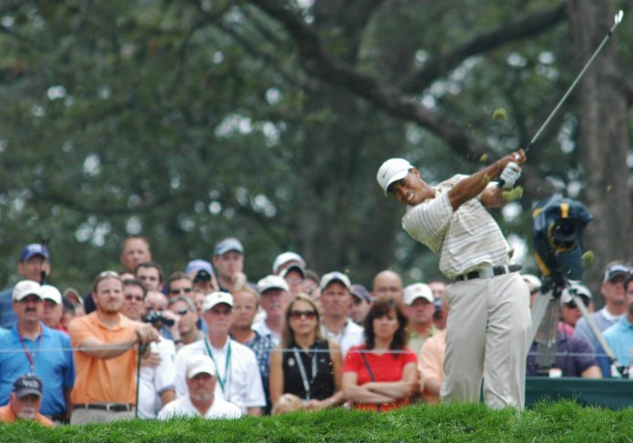 IN 2016, AMERICA counted only 23.8 million golfers, down from its peak of 30.6 million in 2003, according to the National Golf Foundation. Above, Tiger Woods hits his tee shot on 13 at the PGA Championship in Medinah, Ill. in 2006. / BLOOMBERG FILE PHOTO/JOE TABACCA