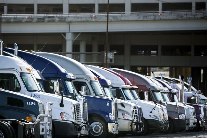 ON SUNDAY, police nationwide began enforcing rules requiring most big rigs to use electronic logging devices to record driver hours. / BLOOMBERG FILE PHOTO/T.J. KIRKPATRICK