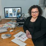 NEW ­DESIGNS: Elana Carello, owner of Elana Carello Sweaters, sketches new designs. She has found success in pop-up shops and artisan shows and has seen her sales grow.  / PBN FILE PHOTO/­MICHAEL SALERNO