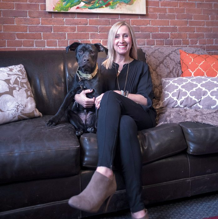 MANY ROLES: Tuni Schartner, owner of TS Consulting, chief marketing officer of The Mill at Lafayette and director of The Hive co-working space, still finds time with her dog Homer. / PBN FILE PHOTO/­MICHAEL SALERNO