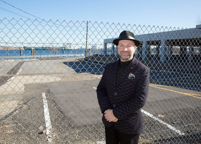 CENTRAL LOCATION: David Dadekian, owner and founder of Eat Drink RI, stands in front of the site of the former Shooters nightclub at 25 India St. in Providence, where he has proposed to create Central Market, a retail center where the public can gather and experience the best of the state's small food-production businesses.  / PBN PHOTO/TRACY JENKINS