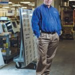After serving as national sales manager for National Marker Co., Michael J. Black bought the manufacturer of safety signs, tags and labels in 2012. And while he has increased innovation and production, he is very happy to invest in his people. / PBN PHOTO/RUPERT WHITELEY