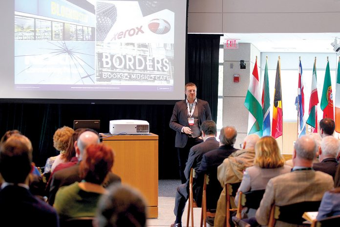 TRADE DISCUSSION: Cris Beswick, director of innovation consulting at Culture Consultancy, strategic adviser on innovation at Wazoku and a visiting fellow at Cranfield School of Management and the Centre for Customised Executive Development in England, speaks during last year's annual World Trade Day at Bryant University. The university will host the 33rd annual World Trade Day on May 23. / COURTESY BRYANT UNIVERSITY