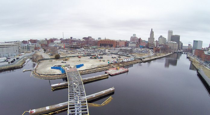 The new pedestrian bridge's steel frame is close to fully spanning the Providence River, as construction workers continue building the new bridge by utilizing the existing stone piers from the old Interstate 195 corridor as its foundation. Work on the $21.9 million project began in fall 2016 and is expected to finish by next summer. The project was supposed to wrap up by this fall, however it was delayed due to problems with steel fabrication. Daniel O'Connell's Sons is the project's general contractor and Inform Studios is the architect. The bridge's length will be 450 feet, and the width will vary between 15 feet and 60 feet. It will have two decks, with the upper main deck being about 10,000 square feet in size, while the lower deck – built lower toward the river – will be about 1,500 square feet.  / COURTESY R.I. DEPARTMENT OF TRANSPORTATION