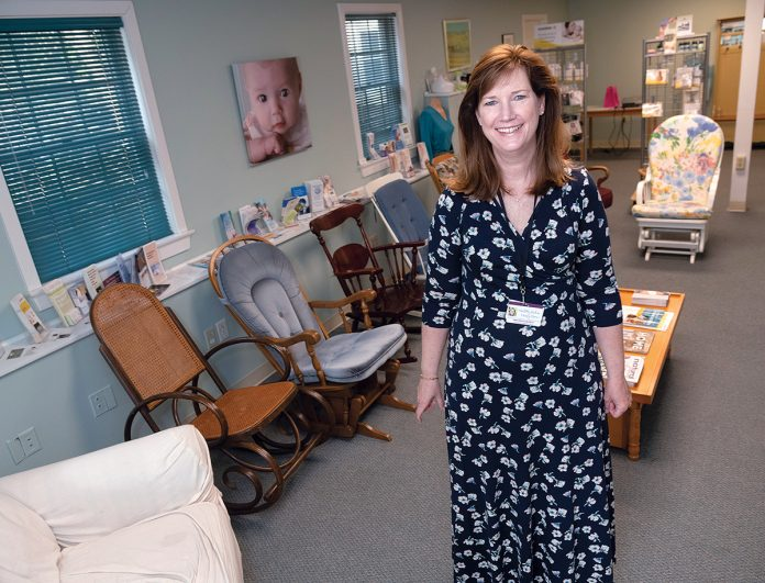 INFANT CARE: Kathleen F. Moren is the founder and CEO of Healthy Babies, Happy Moms. The company offers classes and support, as well as equipment for infant care and breastfeeding. / PBN PHOTO/MICHAEL SALERNO