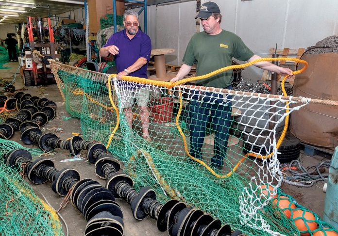 PROGRAM TRAINERS: Fred Mattera, left, program director and trainer for the Commercial Fisheries Center of Rhode Island apprenticeship program for new crew members for the Rhode Island fishing fleet, with Jon Knight, owner of Superior Trawl. Knight is net-repair trainer for the center. / PBN PHOTO/MICHAEL SALERNO