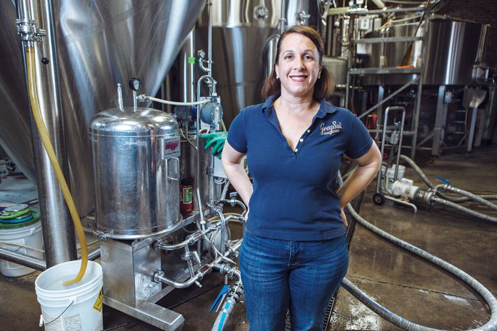 SPIRITED CULTURE: Jennifer Brinton, co-owner of Grey Sail Brewing of Rhode Island in Westerly, strives to maintain a family atmosphere and culture at the brewery. / PBN PHOTO/RUPERT WHITELEY