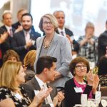 AT THE TOP OF HER GAME: BankNewport President and CEO Sandra J. Pattie heads to the podium at the 2018 PBN Business Women Awards luncheon to accept her Career Achievement award.  / PBN PHOTO/RUPERT WHITELEY