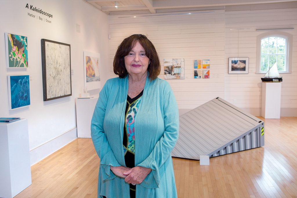 ARCHIVE SUPPORT: Bristol Art Museum Chairwoman Jane Lavender, pictured in the museum's Livingston Gallery, supports Secretary of State Nellie M. Gorbea's call for a new state archive, understanding there's an important relationship between proper archiving and museum exhibitions. / PBN PHOTO/KATE WHITNEY LUCEY